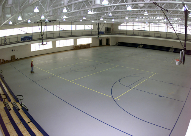 From the suspended track, people can view two full size basketball courts at the Barksdale Sports and Physical Fitness Center. The new facility is 48,000 square feet in area that offers four raquetball courts, an 1/8th of a mile indoor track, a cardio theater, a fully equipped free machine weight room, men's and women's locker room with one-day use lockers, private saunas, and a dedicated aerobic room along with other features. The new center will open it's doors to the base population June 26, 2001