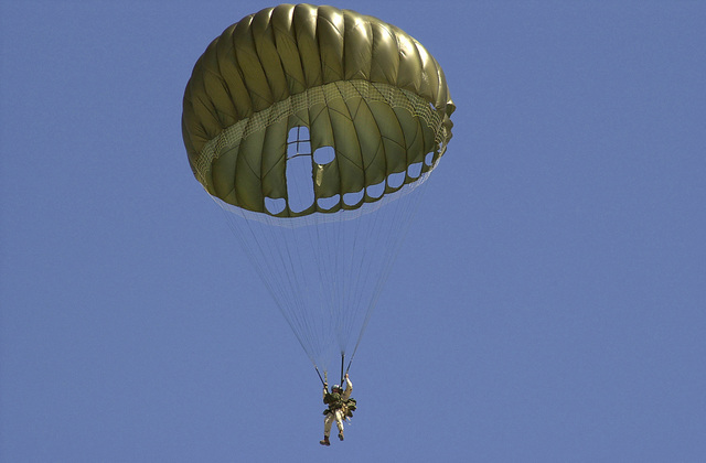In participation with EXERCISE DESERT RESCUE IX, AirForce personnel with the 38th Rescue Squadron, Moody AFB, Georgia, perform Static jumps from the HC-130 near the B-16 range at Fallon Naval AirStation, Nevada.Desert Rescue IX is the premiere search and rescue (SAR) training exercise involving Navy, Army, AirForce and Marine personnel. It is conducted at the ranges of Fallon Naval Air Station, Nevada