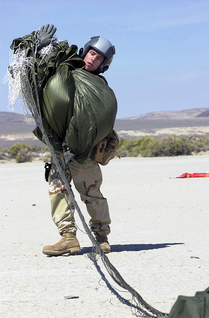 In participation with EXERCISE DESERT RESCUE IX, SENIOR AIRMAN Terra Barrington with the 38th Rescue Squadron, Moody AFB, Georgia (hometown of Santa Rosa, California), completes a Static line jump from the HC-130 near the B-16 range at Fallon Naval AirStation, Nevada.Desert Rescue IX is the premiere search and rescue (SAR) training exercise involving Navy, Army, Air Force and Marine personnel. It is conducted at the ranges of Fallon Naval Air Station, Nevada