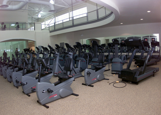 One of the features that the Barksdale Sports and Fitness Center offers, is a state of the art cardio theater in the cardio-aerobic room. The new facility is 48,000 square feet that offers four racquetball courts, an 1/8th of a mile indoor track, a cardio theater, a fully equipped and free machine weight room, men's and women's locker room with one-day use lockers, private saunas, and a dedicated aerobic room along with other features. The new center will open it's doors to the base population June 26, 2001