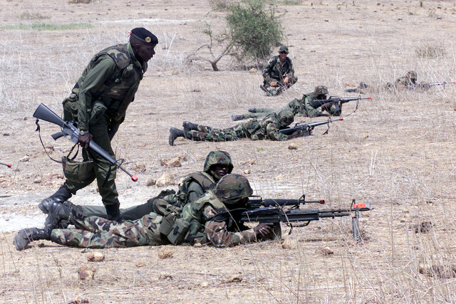 Soldiers of the 1ST Infantry Battalion, Senegal Army members with M-16A1s and an M-60 Machine Gun, execute troop movement formations during OPERATION FOCUS RELIEF II (OFR II) in Thies, Senegal. OFR II is an operation provided by the US Army Special Forces to the Senegal Army for training on new equipment and fighting tactics to bring up their proficiency level for peace enforcement in Sierra Leone