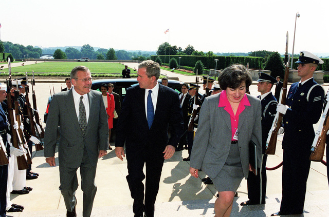 The Honorable Donald H. Rumsfeld, U.S. Secretary of Defense, (left), and Dinah Cohen (right), Director of Computer/Electronic Accommodations Program Technology Evaluation Center, escort President George W. Bush (center), through an honor cordon and into the Pentagon, Washington, D.C., on Jun. 19, 2001.(DoD photo by Helene C. Stikkel) (Released)