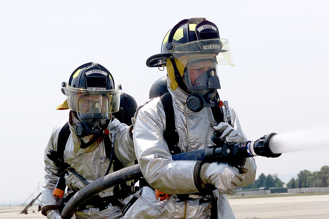 AIRMAN (AMN), James Burke and AMN, David Barrington, USAF, Fire Protection Specialists, 31ST Civil Engineer Squadron, Fire Protection Flight, practice hose handling during a fire fighters training course at Aviano AB, Italy