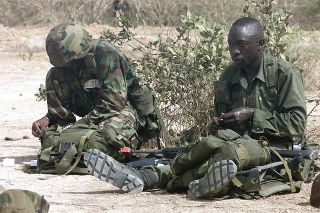 Soldiers of the 1ST Infantry Battalion Senegal Army reload ammunition for their M-16A1 Assault Rifles while conducting troop movement training during Operation FOCUS RELIEF II (OFR II) in Thies, Senegal. OFR II is an operation provided by the US Army Special Forces to the Senegal Army for training on new equipment and fighting tactics to bring up their proficiency level for peace enforcement in Sierra Leone