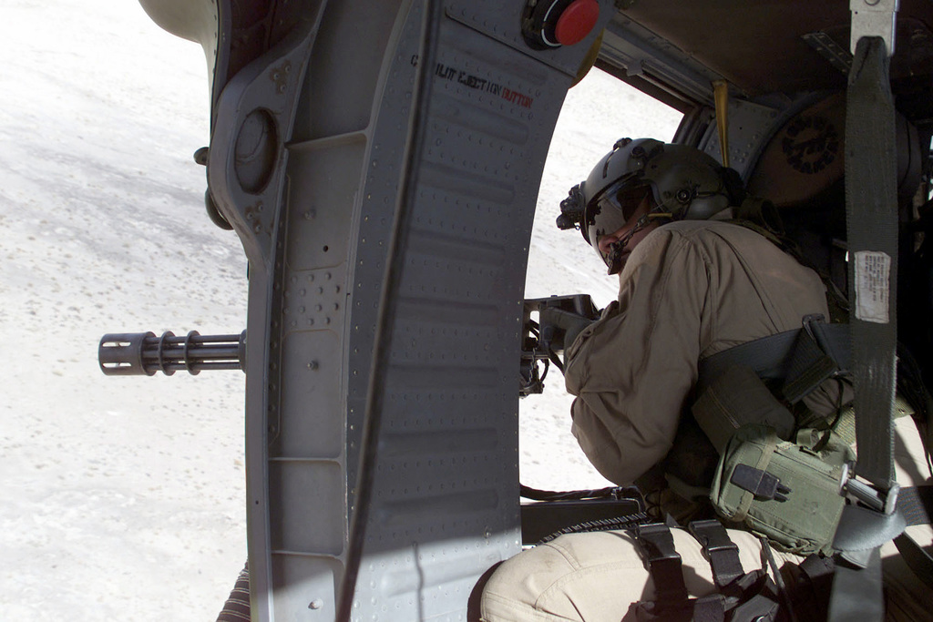 STAFF Sergeant Dave Lacey, a gunner with the 41st Rescue Squadron, fires his weapon, a 7.62mm minigun, out of an HH-60G Pave Hawk helicopter at ground targets. The 41st Rescue Squadron is taking part in the DESERT RESCUE IX exercise at Fallon Naval Air Station (NAS), Nevada. Desert Rescue is a Combat Search and Rescue (CSAR) exercise bringing together elements from all branches of the service in a series of real world rescue and combat scenarios