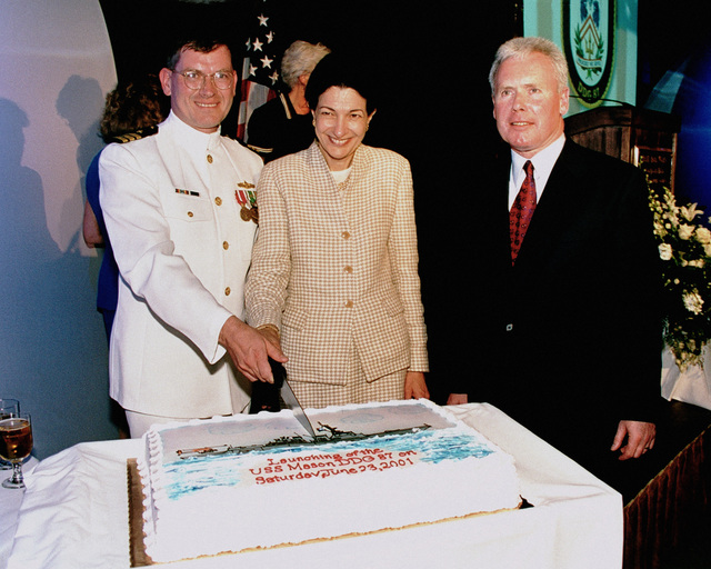 A view of the official cake cutting ceremony following the christening of the guided missile destroyer USS MASON (DDG 87). Left to right: Commander David Gale, USN Prospective Commanding Officer, the Honorable Olympia J. Snowe, US Senator, Maine and ships sponsor, and Mr. Allan C. Cameron, CEO, General Dynamics Company