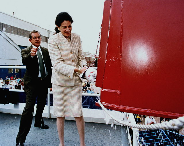 The Honorable Olympia J. Snowe, US Senator, Maine, breaks the traditional bottle of champagne across the bow of the guided missile destroyer USS MASON (DDG 87) to christen the Navys newest destroyer