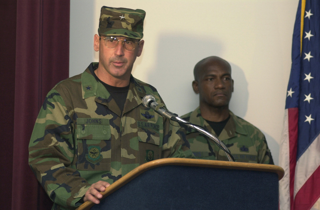 Brigadier General Raymond E. Johns speaks to the distinguished visitors and the participants of Defender Challenge after being presented The Order of the Bayonet, at McChord Air Force Base, Washington. The Order of the Bayonet was established in 1981 to recognize those who have made significant contributions to security and ground defense of air bases. Air Mobility Command defenders nominate candidates based on their accomplishments, not their position or rank. This is the highest honor security police men and women can bestow upon a person