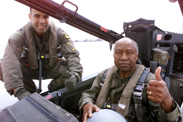 Captain Adrian Spain, left, 27th Fighter Squadron F-15 Pilot, and Lieutenant Colonel (ret) Francis Horne give a thumbs up prior to their flight. Horne is one of the original Tuskegee AIRMAN