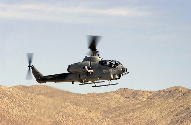 A Marine UH-1 Cobra heads back to home station after hitting a simulated target on range B-17 during part of DESERT RESCUE IX exercise. Desert Rescue is the premiere Search And Rescue (SAR) training exercise involving Navy, Army, Air Force, and Marine personnel. It is conducted at the ranges of Fallon Naval Air Station, Nevada