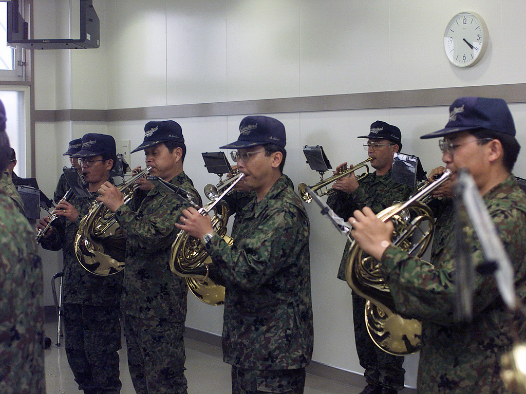 Japanese Ground Self Defense Force Soldiers in the 6th Division Band play during the opening ceremonies welcoming US Marines as they prepare for a live fire exercise at Ojojihara Maneuvering Training Area, Miyagi Prefecture, Japan. In coordination with the Japanese Ground Self Defense Force, 12th Marines from Camp Hansen Okinawa Japan, and 11th Marines India Battery from 29 Palms, California, will conduct live-fire training to sharpen their mission readiness and firing skills with the M198 155mm Medium Towed Howitzer