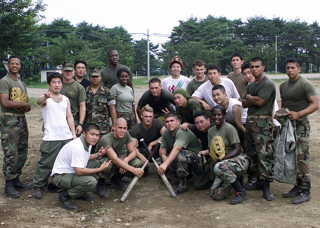 US Marines from 3rd Battalion 11th Marines team up with members from the Japanese Ground Self Defense Force to play a game of softball as Headquarters 12th Marines prepare for a live fire exercise at Ojojihara Maneuvering Training Area, Miyagi Prefecture, Japan. In coordination with the Japanese Ground Self Defense Force, 12th Marines from Camp Hansen Okinawa Japan, and 11th Marines India Battery from 29 Palms, California, will conduct live-fire training to sharpen their mission readiness and firing skills with the M198 155mm Medium Towed Howitzer