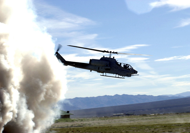 A Marine UH-1 Cobra helicopter provides ground support for friendly forces while participating in the Non Combatant Evacuation exercise in participation with DESERT RESCUE IX. Desert Rescue is the premiere Search And Rescue (SAR) training exercise involving Navy, Army, Air Force and Marine personnel. It is conducted at the ranges of Fallon Naval Air Station, Nevada
