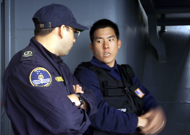 During Exercise TEAMWORK SOUTH 2001, US Navy (USN) Engineman Third Class (EN3) Kyle Yee (right), Visitation Boarding Search and Seizure (VBSS) Bravo Team, instructs a Chilean Navy sailor on Maritime Interdiction Operations (MIO) methods, standing aboard the Chilean Navy Ship BLANO ENCALADA (DHL 15)