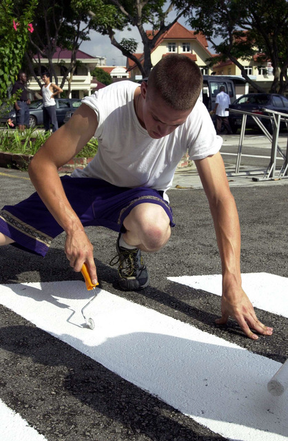 Private First Class (PFC) Adam Rysdyk, United States Marine Corps (USMC), from Titusville, Florida, assigned to Landing Force CARAT 2001, lends a hand by making improvements to the property at the Asian Women's Welfare Association Special School in Singapore