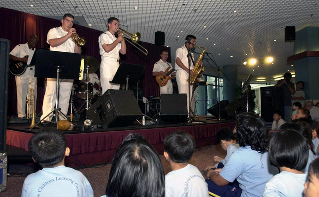 Band members from the United States Navy (USN) Seventh Fleet Band, from Yokosuka, Japan, entertain young music enthusiasts at the KK Women's and Children's Hospital in Singapore, during the seventh annual Cooperation Afloat Readiness and Training (CARAT) 2001 exercise