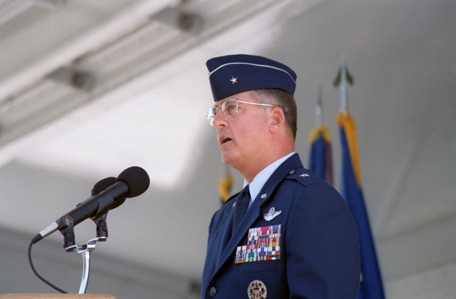 Brigadier General (BGEN) Robert Murdock, USAF, San Antonio - Air Logistics Center (SA-ALC) Commander, addresses former Kelly AFB employees and guests during Kelly AFB closing ceremony. Although the closing ceremony is in history books, government officials still actually own Kelly property and will until federal and state environmental regulators okay remedies for the installation's 30 sites that need environmental clean-up, according to federal law provisions