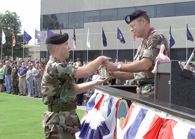 During his Retirement Ceremony, Lieutenant General (LGEN) Lawson W. Magruder III, USA, Deputy Commanding General and CHIEF-of-STAFF US Army Forces Command accepts a shell casing from a US Army Military Police (MP) Honor Guard member