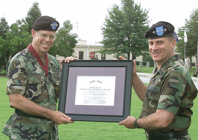 General (GEN) John W, Hendrix (right), USA, Commanding General US Army Forces Command, presents a framed certificate to Lieutenant General (LGEN) Lawson W. Magruder III, USA, Deputy Commanding General and CHIEF-of-STAFF US Army Forces Command, during LGEN Magruders Retirement Ceremony