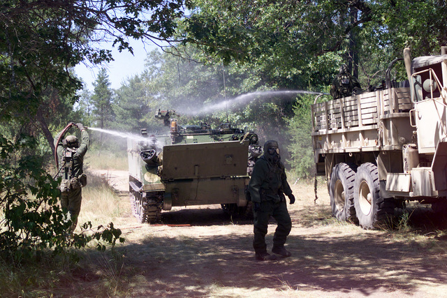 Illinois Army National Guardsmen, 135th Chemical Company decontaminate an M113A Armored Personnel Carrier (APC), Fort McCoy, Wisconsin