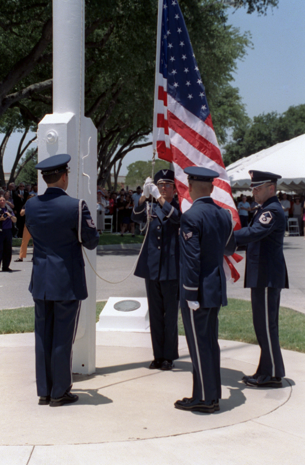 Kelly AFB honor guard lowers the bases American flag, during Kelly AFBs closing ceremonies. Although the closing ceremony is in history books, government officials still actually own Kelly property and will until federal and state environmental regulators okay remedies for the installation's 30 sites that need environmental clean-up, according to federal law provisions
