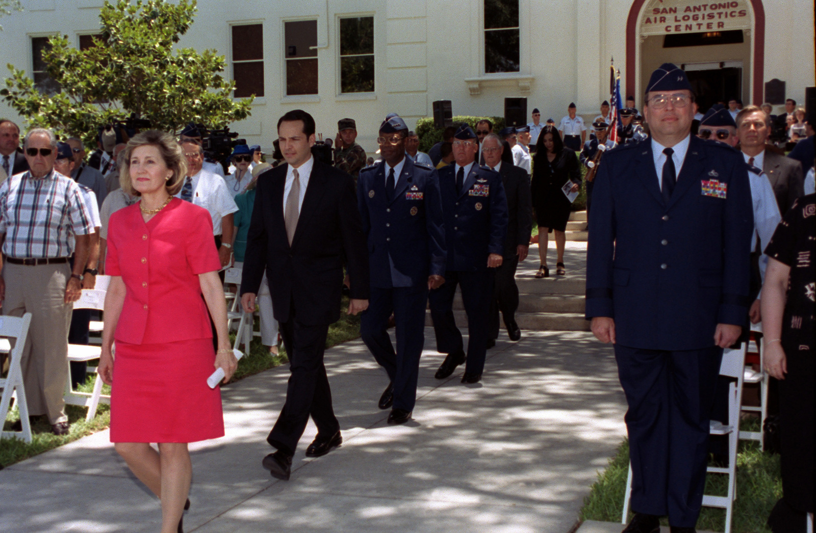 Senator Kay Bailey Hutchison (R), (left), San Antonio Mayor Ed Garza, General (GEN) Lester L. Lyles, Air Force Material Command, commander, Brigadier General (BGEN) Robert Murdock, USAF, and Tommy Jordan Executive Director San Antonio Logistic Center, walk toward center stage during Kelly AFB Closing Ceremonies. Although the closing ceremony is in history books, government officials still actually own Kelly property and will until federal and state environmental regulators okay remedies for the installation's 30 sites that need environmental clean-up, according to federal law provisions