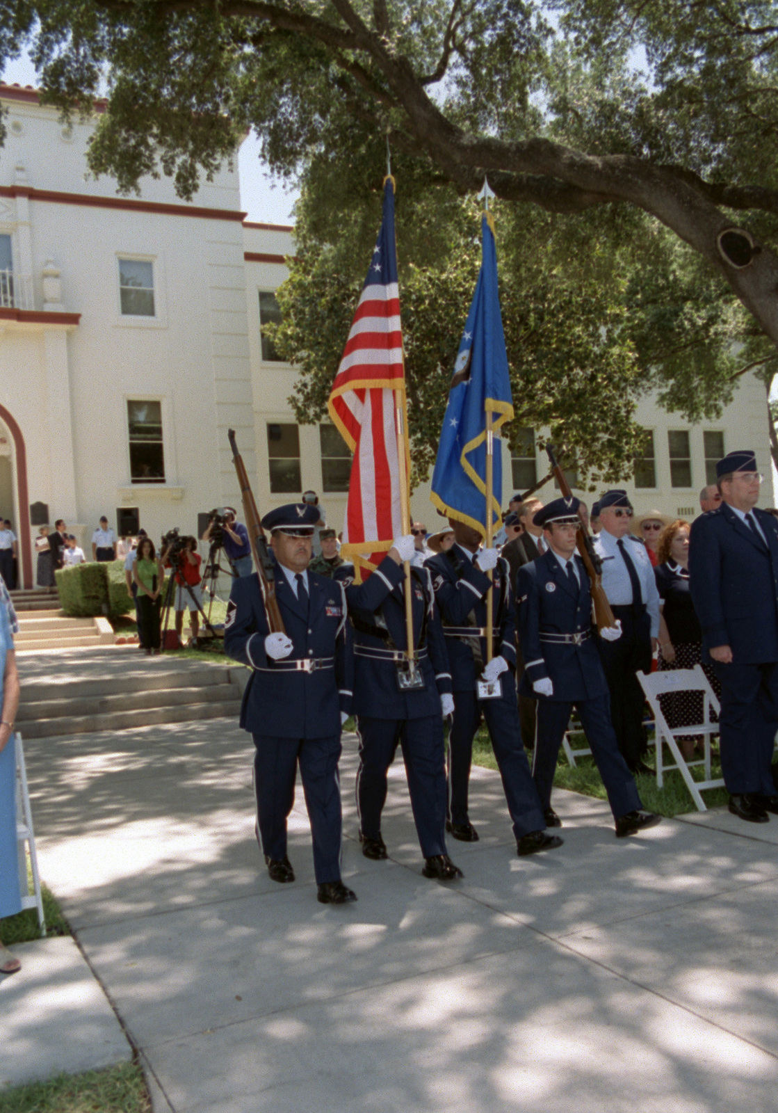 The base Honor Guard posts the colors, during the Kelly AFB closing ceremonies. Although the closing ceremony is in history books, government officials still actually own Kelly property and will until federal and state environmental regulators okay remedies for the installation's 30 sites that need environmental clean-up, according to federal law provisions