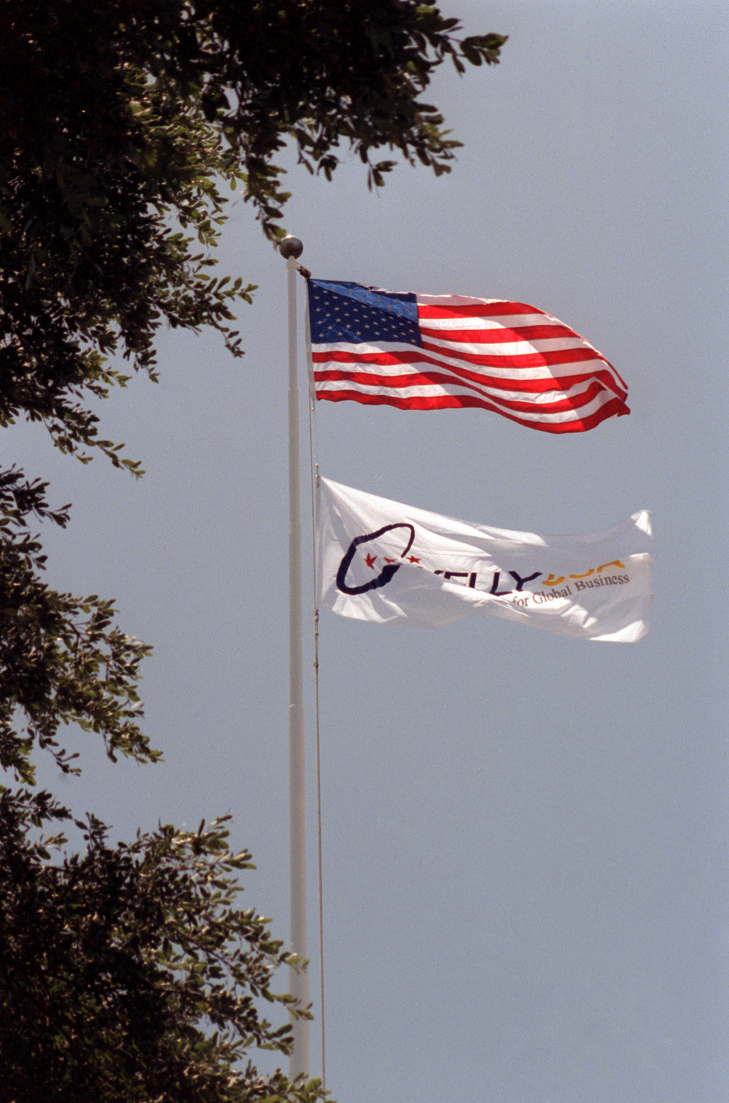 The San Antonio Air Logistics Center (Kelly AFB) flag no longer flies. In its place, the new KellyUSA Business Park flag flies. Although the closing ceremony is in history books, government officials still actually own Kelly property and will until federal and state environmental regulators okay remedies for the installation's 30 sites that need environmental clean-up, according to federal law provisions