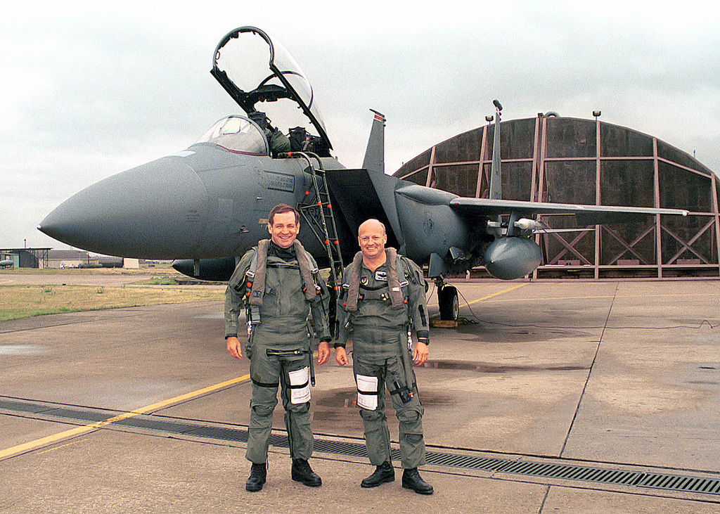 Brigadier General (BGEN) Hugh Forsythe, Individual Mobilization Augmentee (IMA) advisor to United States Air Forces in Europe (USAFE), left, and Major Bruce Smith, a pilot from the 494th Fighter Squadron, 48th Fighter Wing, Royal Air Force Lakenheath, United Kingdom, pose for a picture prior to their flight in a F-15E Strike Eagle. BGEN Forsythe was visiting the base to get a familiarization of the bases' mission and to be briefed on the future of the F-22 Raptor program