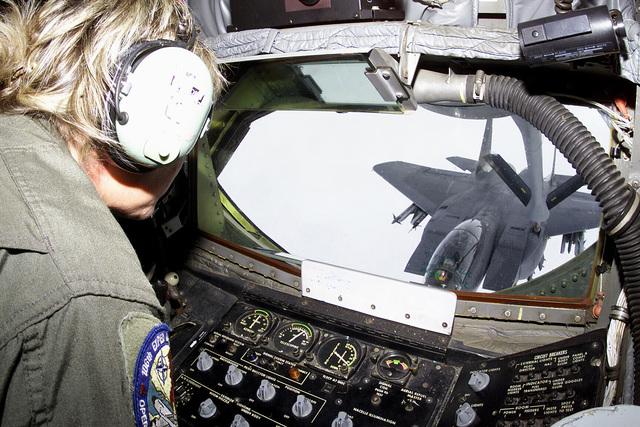 KC-135 boom operator MASTER Sergeant (MSGT) Caroline Beardin, 106th Air Refueling Squadron, Alabama Air National Guard, oversees the refueling of an F-15E Strike Eagle