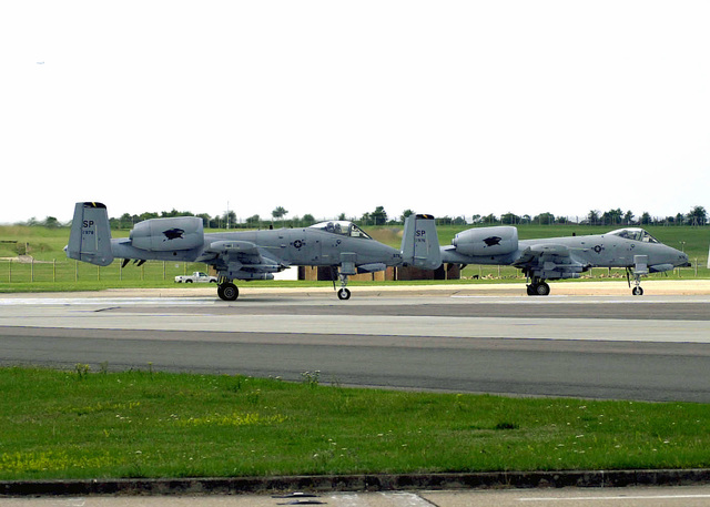 A-10 Thunderbolts from the 81st Fighter Squadron Spangdahlem Air Base, Germany, wait for take off in the aircraft hold area at Royal Air Force (RAF) Lakenheath, United kingdom. Personnel from the 52d Fighter Wing are currently deployed to RAF Lakenheath in preparation for the NATO Tactical Evaluation in October
