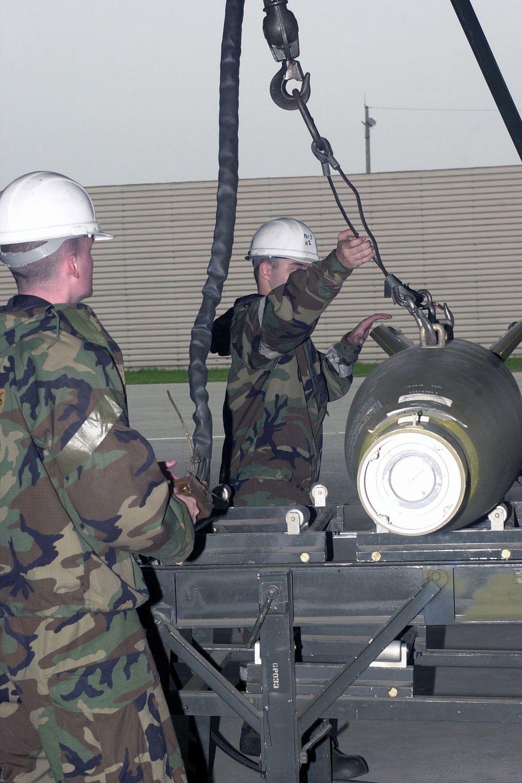 SENIOR AIRMAN (SRA) Joshua Maines and SRA John Strength refrag a trailer with GBU12 laser guided bombs during the Initial Response Readiness Exercise/Combat Employment Readiness (IRRE/CERE) exercise at Osan Air Base, Republic of Korea. The quarterly exercise tests the 51st Fighter Wing's ability to respond to combat situations