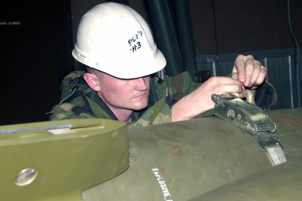 SENIOR AIRMAN (SRA) Joshua Maines locks down a GBU12 laser guided bombs during the Initial Response Readiness Exercise/Combat Employment Readiness (IRRE/CERE) exercise at Osan Air Base, Republic of Korea. The quarterly exercise tests the 51st Fighter Wing's ability to respond to combat situations