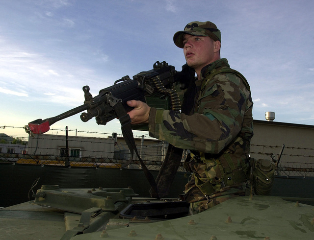 """A member of the Mobile Reserve security force calls out a """"halt"""" towards OPFOR (Opposition Forces) members along a perimeter breech during Exercise BEVERLY BULLDOG, a combination of an Initial Response Readiness Exercise (IRRE) and a Combat Employment Readiness Exercise (CERE). The Mobile Reserve is a unit tapped to provide extra security after or during an attack. They are taking part in Kunsan's July base wide exercise to keep a sense of readiness in the ongoing peacekeeping mission on the Korean peninsula"""