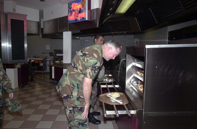 General Michael E. Ryan, Air Force CHIEF of STAFF, decides what to eat for lunch at the Rheinland Pfalz Dining Facility, during his visit to Ramstein Air Base Germany 26-27 July