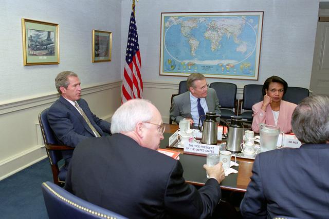 (Clockwise), U.S. President George W. Bush, Donald H. Rumsfeld, U.S. Secretary of Defense, Condoleeza Rice, U.S. National Security Advisor, and U.S. Vice President Richard B. Cheney, attends a briefing at the Pentagon, Washington, D.C., on Aug. 1, 2001.  (DoD photo by Helene C. Stikkel) (Released)