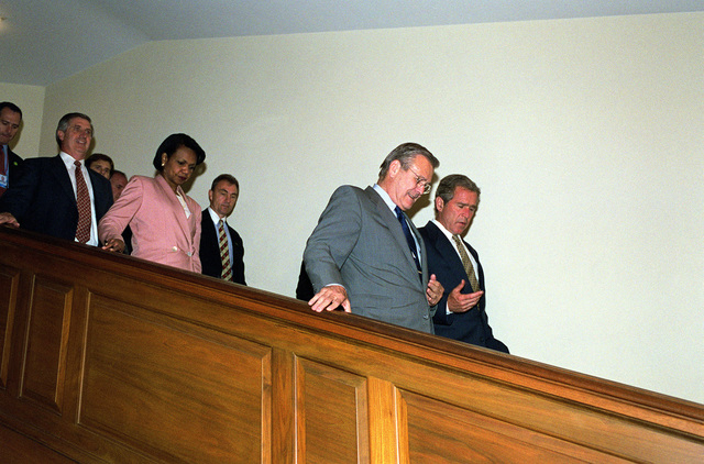 President George W. Bush (right) talks with The Honorable Donald H. Rumsfeld (left), U.S. Secretary of Defense, as they walk down the stairs after a briefing at the Pentagon, Washington, D.C., on Aug. 1, 2001. Accompanying the President are The Honorable Dr. Condolezza Rice (third from left), National Security Advisor, and Andrew H. Card Jr. (2nd from left), CHIEF of STAFF to the President.(DoD photo by Helene C. Stikkel)  (Released)