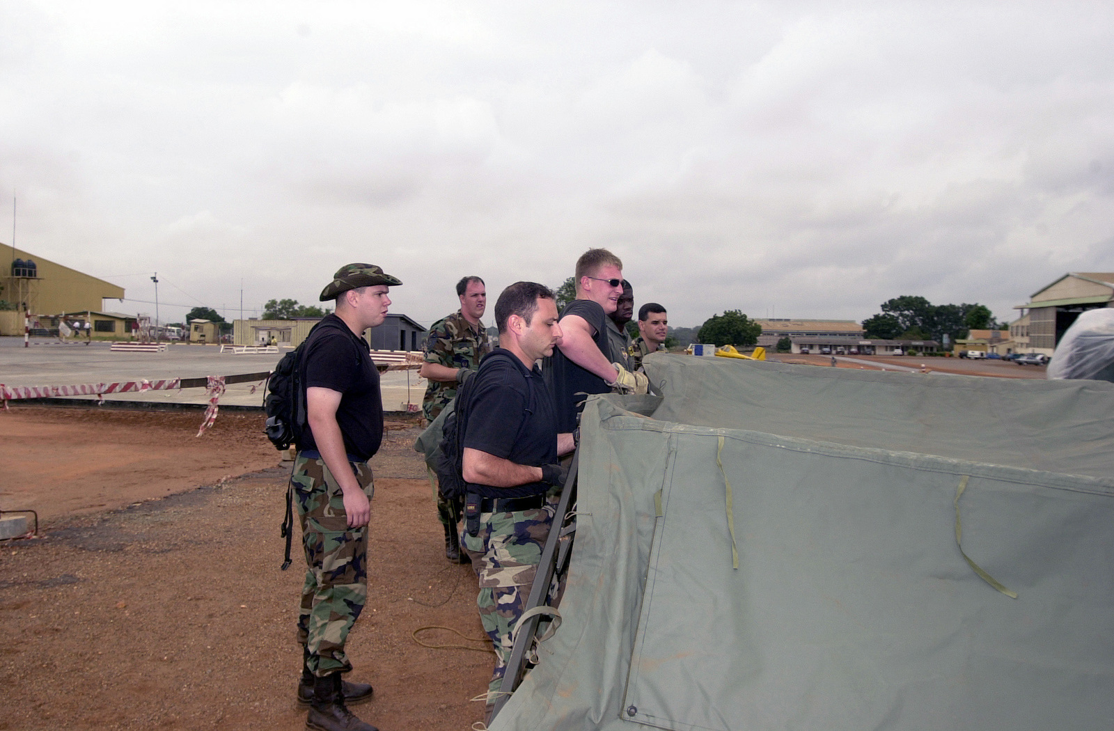 Troops from the 86th Contingency Response Group (CRG), Ramstein Air Base, Germany, assemble a tent at an airfield in Accra, Ghana, in preparation to transport US forces and cargo connected with Operation FOCUS RELIEF. Operation FOCUS RELIEF, a United Nations peacekeeping operation in Sierra Leone, to equip and train seven battalions from West African countries to be able to conduct peace enforcement operations