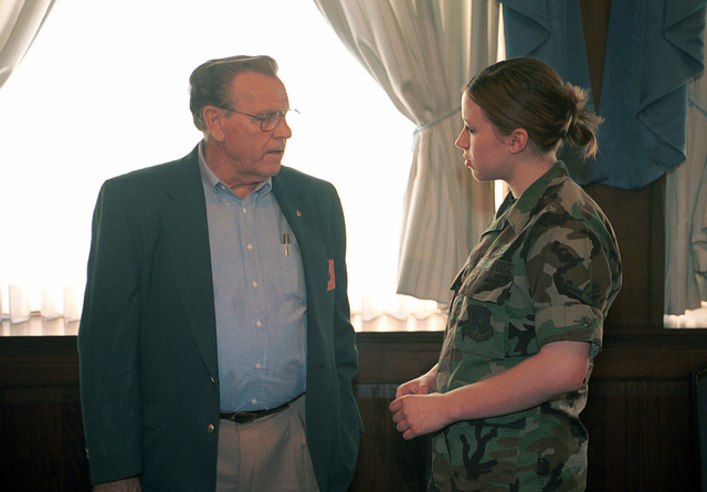 Mr. Ray G. Smith (left) National Commander of the American Legion greets AIRMAN Kelli Jorgenson, USAF, 48th Operational Support Squadron. Mr. Smith met with members of RAF Lakenheath Air Force Sergeant's Association, Chapter 1669, during his visit to RAF Lakenheath, United Kingdom. He spoke with the members about current military affairs & benefits the American Legion is involved in to help improve the military way of life. Mr. Smith and his party are visiting several military installations throughout Europe to gain firsthand knowledge of United States Military and Diplomatic activities in the area and report his findings to the American Legion membership