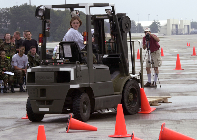 AIRMAN First Class Courtney Brovey, Customer Service Supply Technician, with the 48th Supply Squadron, Royal Air Force Base Lakenheath, United Kingdom, competes in the Supply Forklift Slalom, driving a Hyster Light Duty Forklift truck during Supply Rodeo 2001