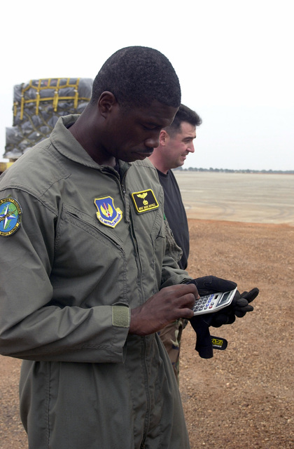 MASTER Sergeant Mark Dupree, USAF, C-17 Loadmaster, 86th Contingency Response Group, Ramstein Air Base, Germany, keys in information on cargo weights into a calculator at the airfield in Accra, Ghana, in preparation to transport US forces and cargo involved in Operation FOCUS RELIEF. Operation FOCUS RELIEF, a United Nations peacekeeping operation in Sierra Leone, to equip and train seven battalions from West African countries to be able to conduct peace enforcement operations