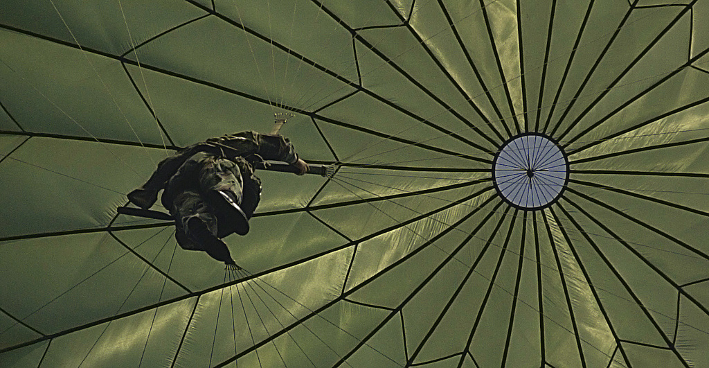 """A member of the Army's 82nd Airborne Division Fort Bragg, North Carolina, parachutes to the ground at Charleston Air Force Base after jumping from a C-17 Globemaster III, 15th Airlift Squadron Charleston AFB, South Carolina. The jump is part of the 82nd Airborne Division Associations annual convention in downtown Charleston Aug. 8-12. 300 members of the 82nd exited the C-17s in six passes. """"The jump is the keystone event,"""" said Captain Terrance McGraw, USA, event coordinator and commander, Headquarters Company, 82nd Airborne Division Support Command, and Fort Bragg, North Carolina, """"It is part nostalgia and here is how we do it today. We have the utmost respect for the World War II..."""