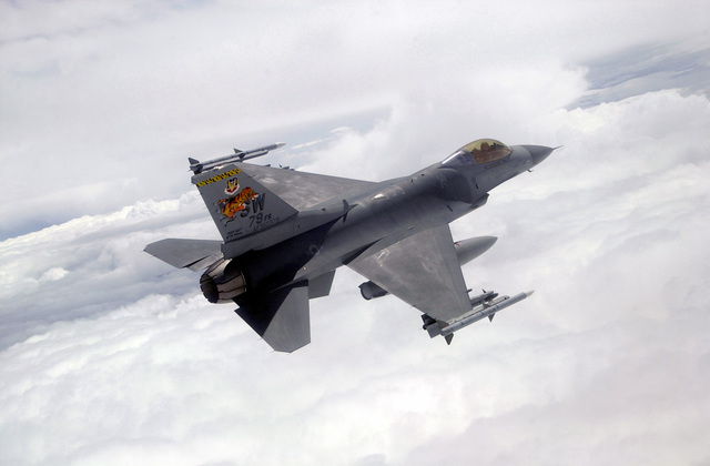 """Lieutenant Colonel James Horton, 79th Fighter Squadron Commander, banks an F-16CJ over western Colorado during """"Tiger Meet of the Americas."""""""