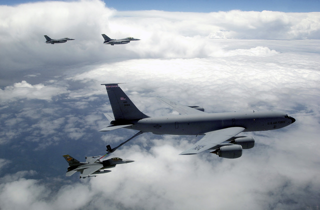 """Lieutenant Colonel James Horton, 79th Fighter Squadron Commander, links his F-16CJ fighter to a KC-135 Stratotanker from the Nebraska Air National Guard, and refuels, while other fighters wait their turn, during """"Tiger Meet of the Americas."""""""