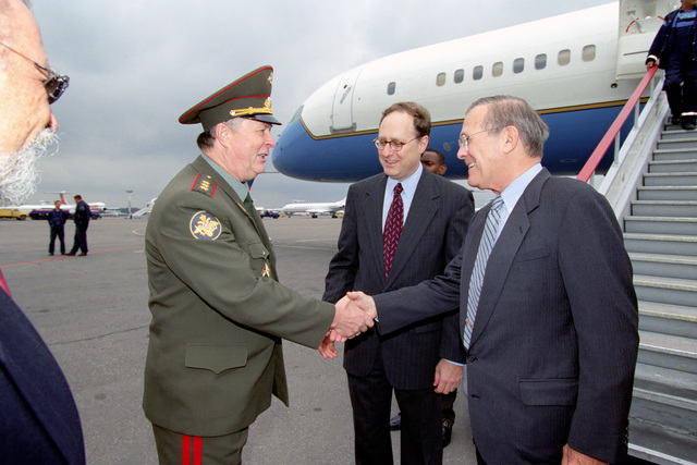 "COL. GEN. Valentin A. Bogdanchikov (left), First Deputy CHIEF of Main Directorate of International Military Coop, greets The Honorable Donald H. Rumsfeld (right), U.S. Secretary of Defense, as U.S. Ambassador to Moscow Alexander""Sandy""Vershbow (center) observes, at Vnukovo International Airport, Moscow, Russia, on Aug. 12, 2001.  (DoD photo by Helene C. Stikkel) (Released)"