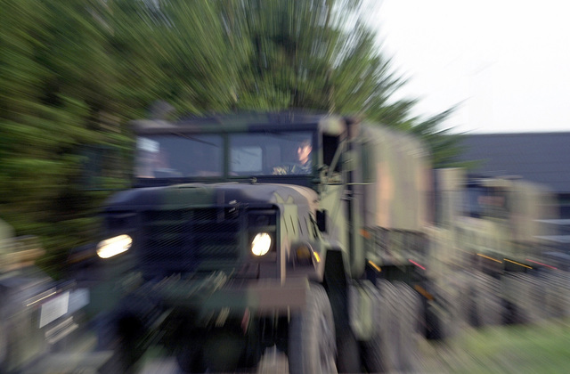 Equipment from the 603rd Air Control Squadron, Aviano Air Base, Italy, rolls into the main site near Tranum, Denmark, on M-939 A2 5 ton trucks during TACTICAL FIGHTER WEAPONRY 2001
