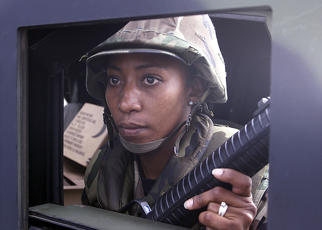 STAFF Sergeant (SSGT) Dawne Roby, USAF, 305th Security Forces, McGuire Air Force Base maintains an alert posture in anticipation of an attack by Opposing Forces (OPFOR). SSGT Roby is defending her position during a MOBILITY EXERCISE (MOBEX). The MOBEX designed to test the ability of the Security Forces to establish and defend an Entry Control Point (ECP) on an air base. The evaluators of the exercise inserted various stresses against the unit, from probing patrols to frontal assault of the ECP. SSGT Roby and her team members successfully accomplished their mission by repelling all of the OPFOR
