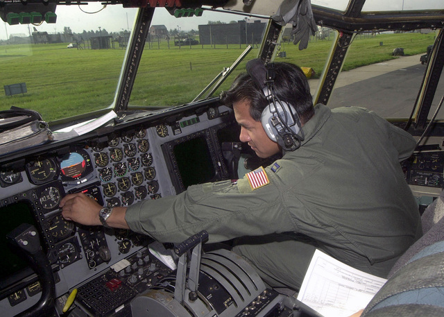 Captain Cesar Sandan, USAF, 7th Special Operations Squadron, RAF Mildenhall, UK, in the co-pilots seat, performs pre-flight checks on an MC-130H Combat Talon II before a local proficiency training flight