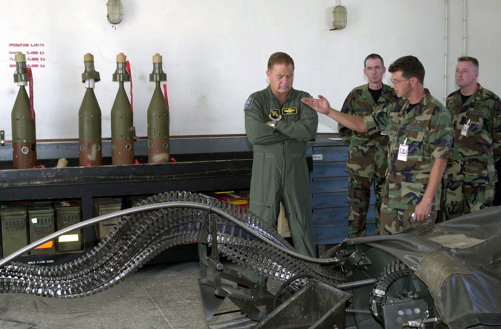 MASTER Sergeant (MSGT) Robert Bishop, USAF, Non Commissioned Officer in Charge of conventional maintenance, briefs Lieutenant General Ronald Keys, USAF, (left), 16th Air Force Commander, about the Universal Ammunition Loading System (UALS) for ammunition into the M61 20mm rotary cannon on USAFE aircraft. MSGT Bishop also points to MAU-169 Computer Control Groups for Laser guided Bombs used for all Operation NORTHERN WATCH aircraft, Incirlik Air Base, Turkey