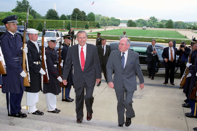 The Honorable Donald H. Rumsfeld (left), U.S. Secretary of Defense, escorts Australian Prime Minister John Howard, through an Honor Cordon and into the Pentagon, where they will discuss the principles of submarine operations. (DoD photo by Robert D. Ward) (Released)